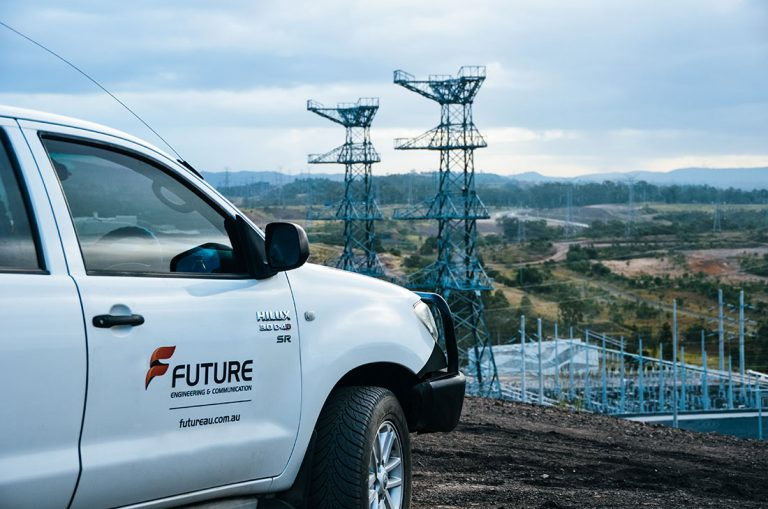 Future Engineering branded vehicle overlooking substation and transmission line works in Brisbane